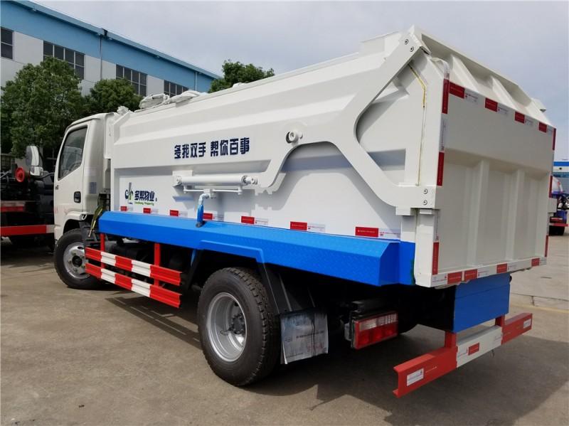 东风5方侧装 compressed garbage truck 后左面图